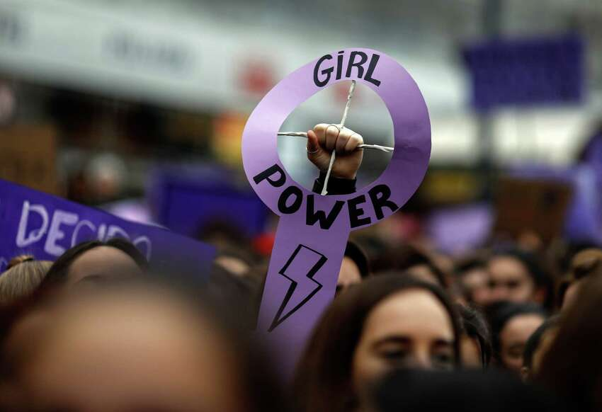 Demonstrators attend a protest at the Puerta del Sol square during a one day strike to defend women's rights on International Women's Day in Madrid, on March 8, 2018. Spain celebrated International Women's Day today with an unprecedented general strike in defence of their rights that saw hundreds of trains cancelled and countless protests scheduled throughout the day. / AFP PHOTO / OSCAR DEL POZO (Photo credit should read OSCAR DEL POZO/AFP/Getty Images)