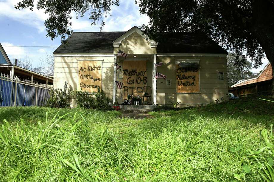 Boards cover the front of a home at 7815 Harding Street in Houston, Friday, Feb. 15, 2019, where the occupants of the home were shot to death during a police raid on Jan. 28. A lead investigator lied in an affidavit justifying a drug raid at the Houston home in which two residents were killed and four undercover officers were shot and wounded during a gun battle, the city's police chief said Friday. (Elizabeth Conley/Houston Chronicle via AP) Photo: Elizabeth Conley,  MBO / Associated Press / © 2018 Houston Chronicle