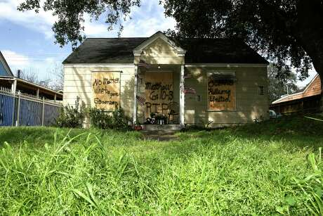 Boards cover the front of a home at 7815 Harding Street in Houston, Friday, Feb. 15, 2019, where the occupants of the home were shot to death during a police raid on Jan. 28. A lead investigator lied in an affidavit justifying a drug raid at the Houston home in which two residents were killed and four undercover officers were shot and wounded during a gun battle, the city's police chief said Friday.