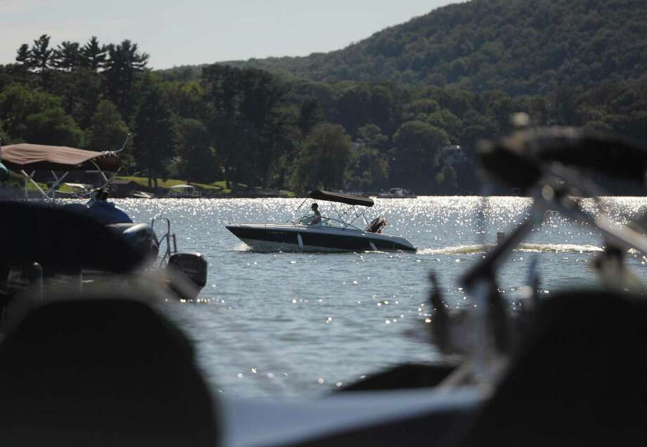 A boater returns to the docks at Echo Bay Marina on Candlewood Lake in Danbury, Conn. Friday, Sept. 12, 2014. Photo: Tyler Sizemore / Tyler Sizemore / The News-Times