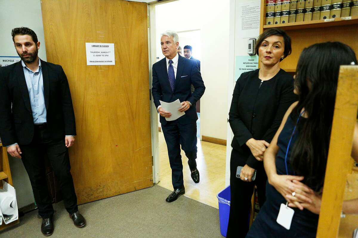 District Attorney George Gasc�n enters the room during a news conference at the Hall of Justice on Thursday, March 7, 2019, in San Francisco, Calif. He introduced AB 1076, a new proposed legislation that would automatically clear eligible criminal and arrest records in California.