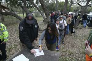 Volunteers are assigned to a team at Eisenhower Park before entering Joint Base San Antonio-Camp Bullis in a search for Andreen McDonald on March 7, 2019. The woman was reported missing March 1. Bexar County Sheriff's deputies have arrested Andre McDonald, her husband, on a charge of tampering with evidence.