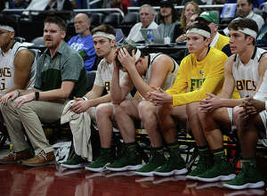 East Chambers' bench reacts as the clock winds down to a loss to Brock during their state semi-final match-up Thursday at the Alamodome. Photo taken Thursday, March 7, 2019 Kim Brent/The Enterprise