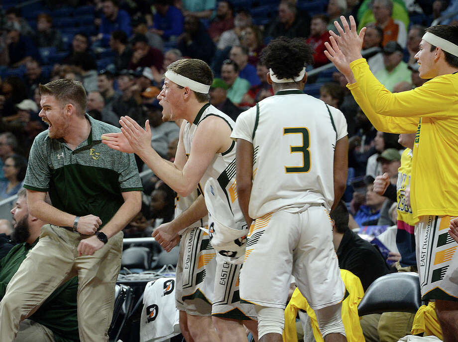 East Chambers' bench reacts as they come back and tie the game at the halk against Brock during their state semi-final match-up Thursday at the Alamodome. Photo taken Thursday, March 7, 2019 Kim Brent/The Enterprise Photo: Kim Brent, The Enterprise / BEN
