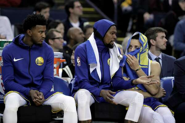 7e249ea7cbad 1of16Kevin Durant (35) and Stephen Curry (30) talk on the bench as the game  begins to get out of hand in the second half as the Golden State Warriors  played ...