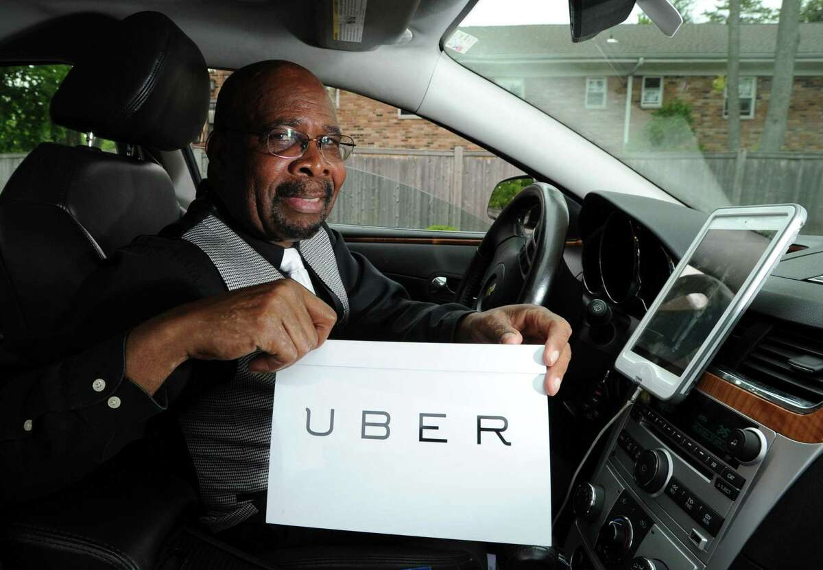Paul Dimiti, of Stamford, who is hearing impaired and recently started driving for Uber, gets ready to head out from his Stamford home on May 17, 2016, to pick up a client.