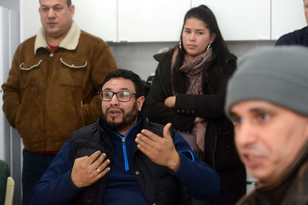Mourad Hassar, of West Haven, speaks about his recent frustrations as a driver for Uber and Lyft during a meeting with other drivers in New Haven, Conn. Feb. 6, 2019.