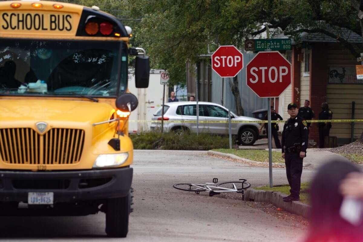 Police investigate a scene where a cyclist was struck and killed by a HISD school bus at Heights Blvd. and 8th Street in the Heights, Thursday, March 7, 2019.