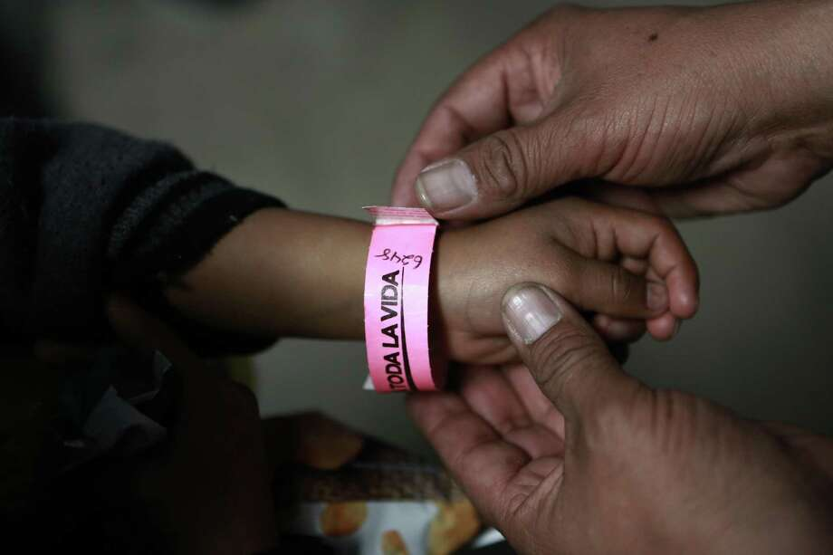 A child in Ciudad Juarez wears a bracelet that indicates his place in line to submit his request for U.S. asylum. The crisis at the border is a humanitarian one. Photo: Christian Torres /Associated Press / Copyright 2019 The Associated Press. All rights reserved.