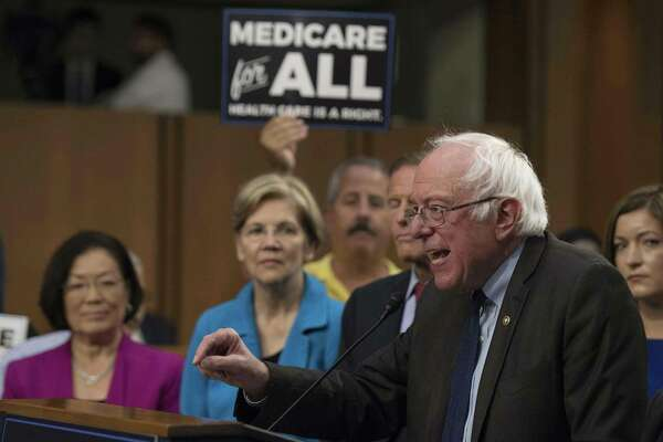 Sen. Bernie Sanders discusses Medicare for All legislation in 2017 on Capitol Hill in Washington, DC. The transition to this would wallop the nation.