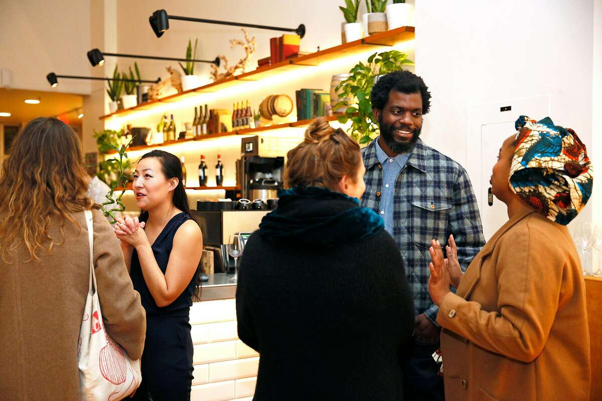From left: Whetstone Media co-founders Melissa Shi and Stephen Satterfield with guests during a preview party for a new issue of Whetstone Magazine at the Alice Collective on Friday, Feb. 15, 2019, in Oakland, Calif.