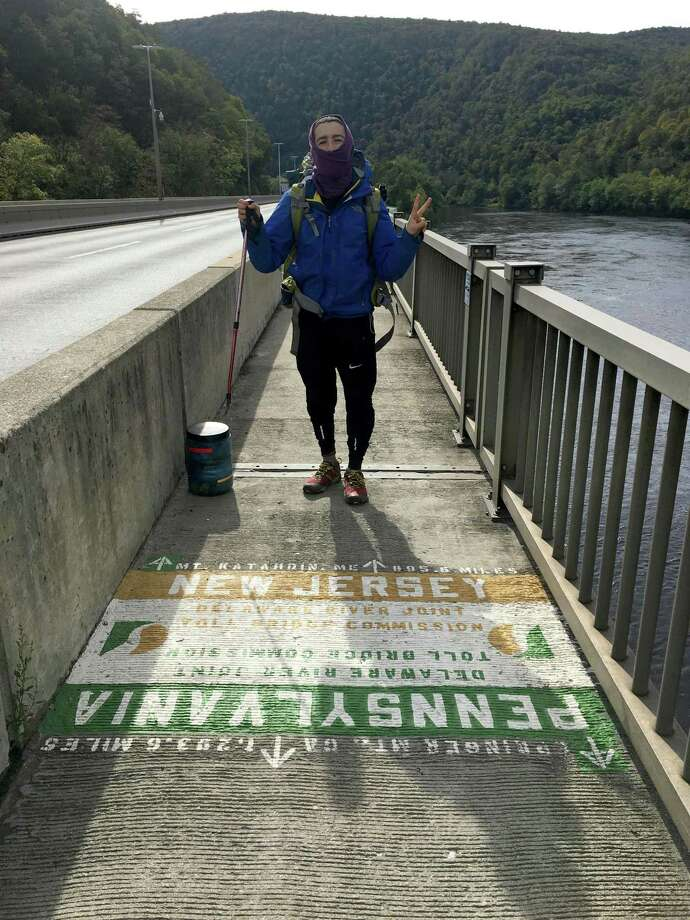 Sometimes, you can be in two places at once. Danbury's Ryan Fox crosses the Delaware River on the border between New Jersey and Pennsylvania during his Appalachian Trail hike last fall. Photo: Contributed Photo