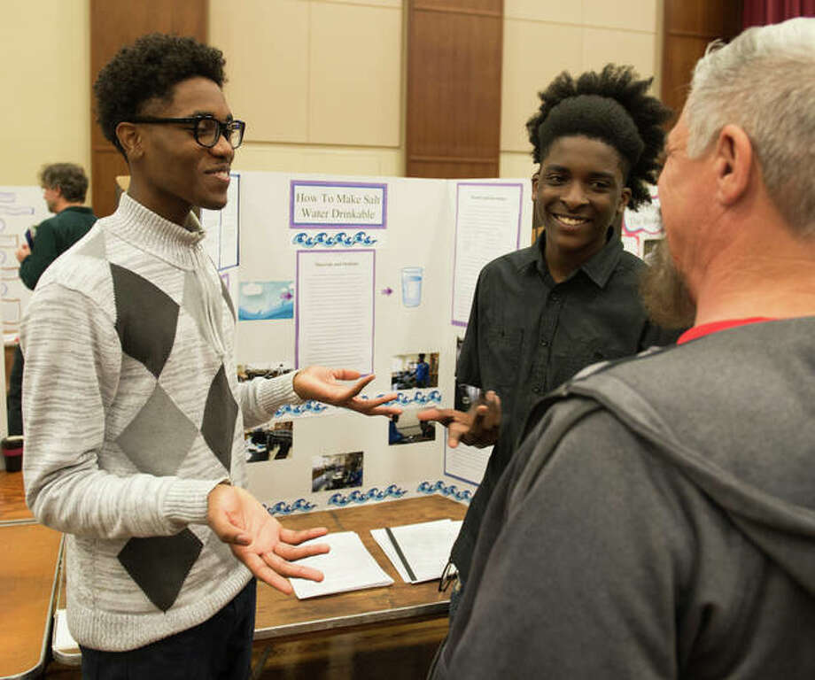 Upward Bound Math and Science students describe their research on How to Make Salt Water Drinkable at the 2018 SERC. Photo: For The Intelligencer