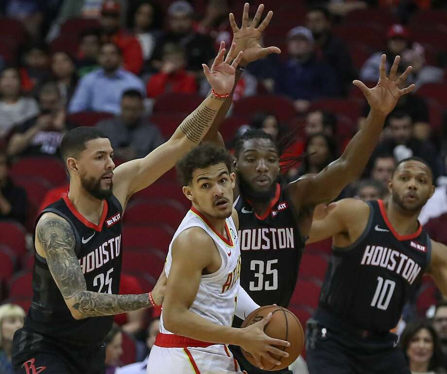 Houston Rockets guard Austin Rivers (25), forward Kenneth Faried (35) and guard Eric Gordon (10) stop Atlanta Hawks guard Trae Young (11) during the first half of an NBA basketball game at Toyota Center on Monday, Feb. 25, 2019, in Houston. Photo: Steve Gonzales, Houston Chronicle / Staff Photographer / © 2019 Houston Chronicle