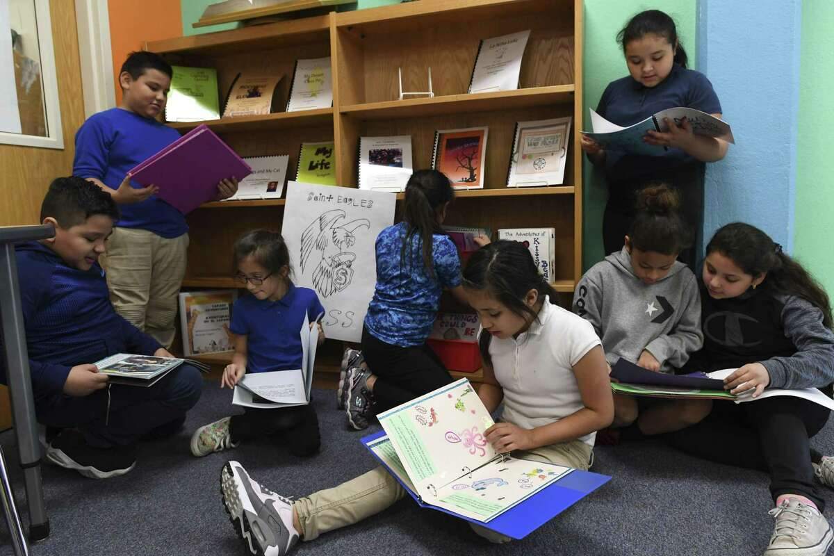 Rodriguez Elementary School students read through books published by fellow students and Our Lady of the Lake University education students on Thursday, March 7, 2019.