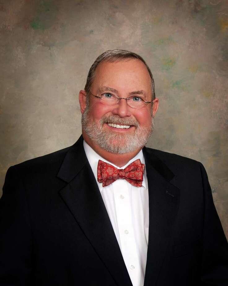 Richard Levacy head and shoulders portrait wearing black suit. / © 2011 Howard Barlow, 1345 Broadway, St., Beaumont, Texas, 77701, USA, 409-656-1332, www.hkbarlow.com, howard@hkbarlow.com. All