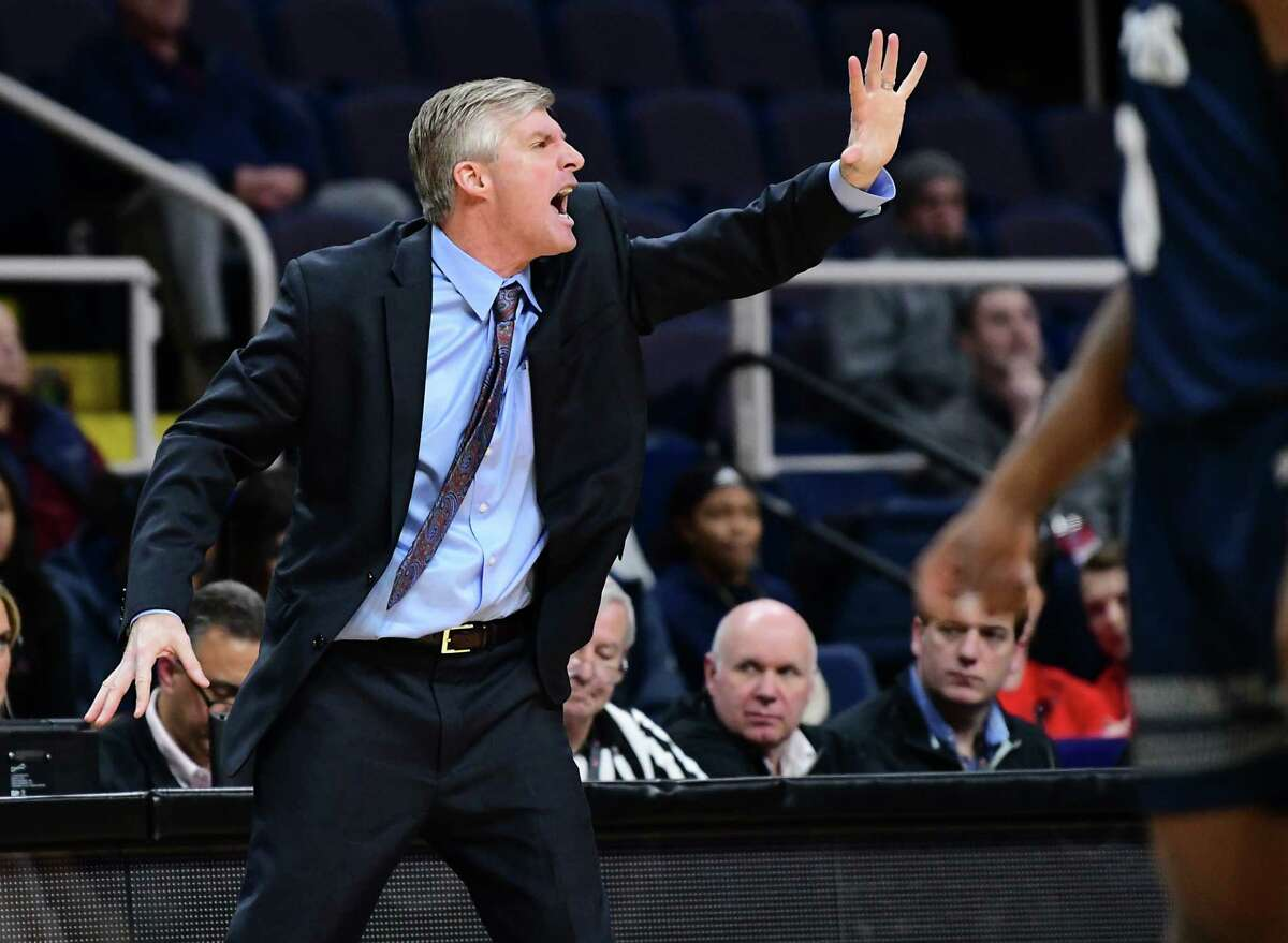Marist head coach John Dunne communicates to his players during a first round MAAC tournament basketball game against St. Peter's at the Times Union Center on Thursday, March 7, 2019 in Albany, N.Y. (Lori Van Buren/Times Union)