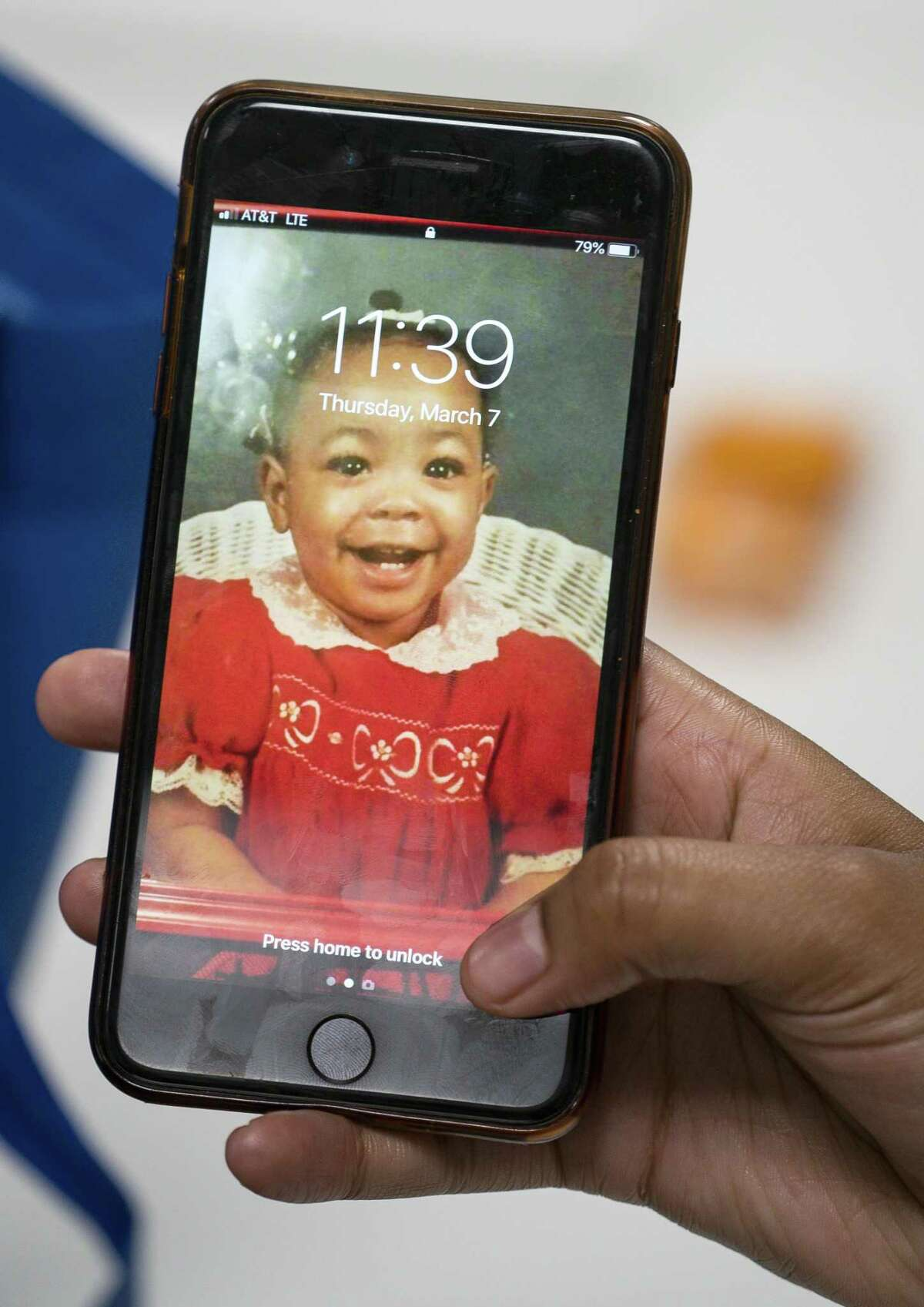 Jonique Ardjon holds up a picture of herself as a baby on her phone at the HAY Center in Houston, Thursday, March 7, 2019. A federal grant recently provided $700,000 for housing vouchers in the Houston area for young adults aging out of foster care.
