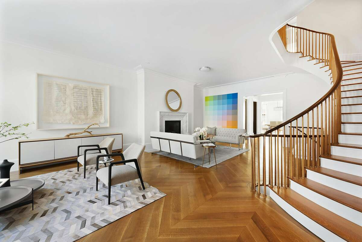 A herringbone-patterned rug complements the herringbone-patterned hardwood floor of this residence in SoHo, New York that was staged by San Francisco-based studio D.