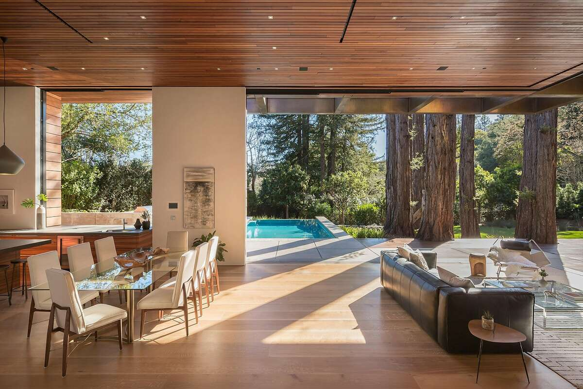 San Francisco-based studio D staging employed glass tables to keep the great room of 9 Woodside Way in Ross feeling open, bright and airy.