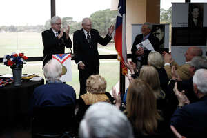City councilman Michael Trost (left) applauds Bill Womack (right) after reading a proclamation honoring Womack during a reception for the Texas Liberators exhibit at the Midland College library, March 7, 2019. The exhibit includes oral histories of Texas World War 2 veterans who assisted in the liberation of Jewish prisoners from Nazi concentration camps. The project is a partnership with the Texas Holocaust and Genocide Commission, and Texas Tech University. James Durbin / Reporter-Telegram