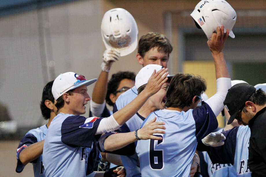 Greenwood's Jared Lewis (6) is is congratulated by teammates after hitting a home run during a West Texas March Classic game against Pecos March 7, 2019, at Greenwood High School. James Durbin / Reporter-Telegram Photo: James Durbin / Midland Reporter-Telegram / ? 2019 All Rights Reserved