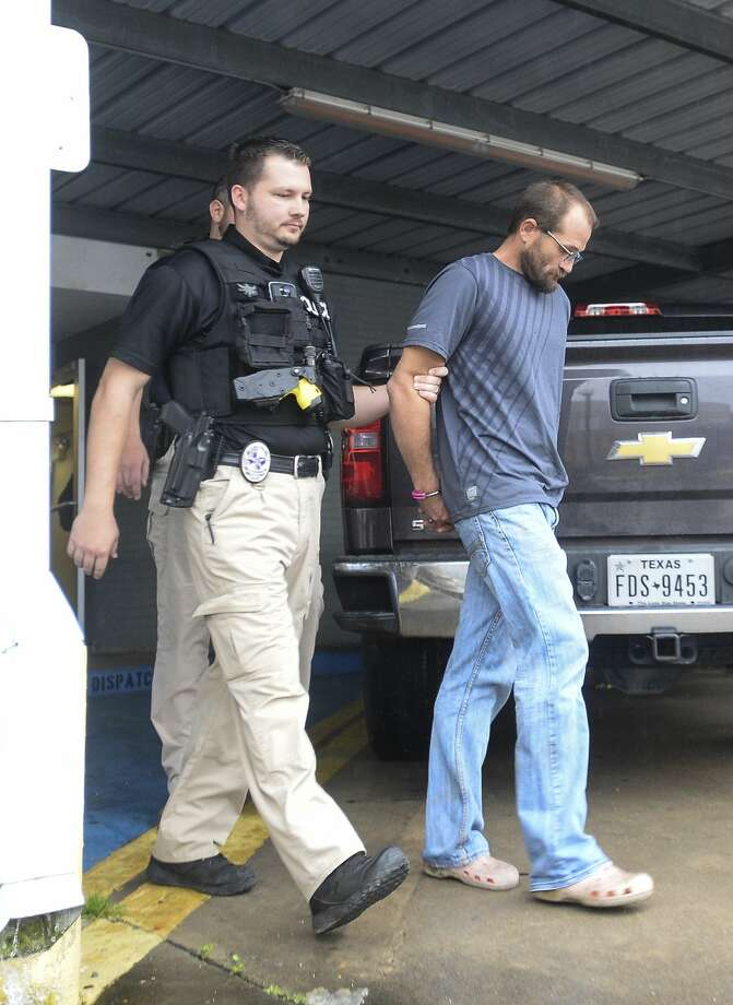 Daniel Shackleford is escorted to a police car from the Port Arthur Police Station. Photo taken on Thursday, 03/07/19. Ryan Welch/The Enterprise Photo: Ryan Welch/The Enterprise