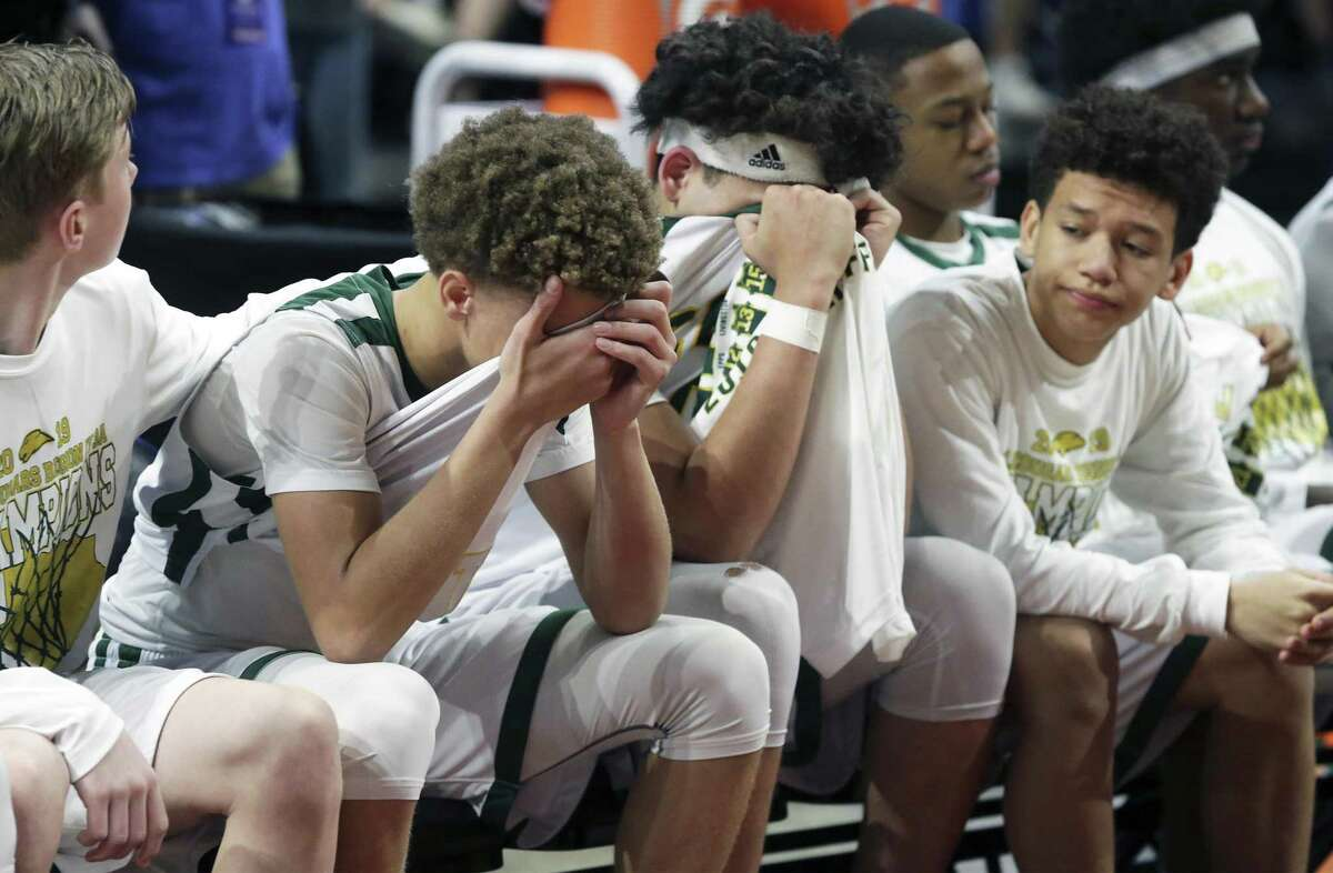 The Cougar bench shows the pain as Cole loses to Dallas Madison in the UIL 3A state semifinal high school boys basketball game on March 7, 2019.