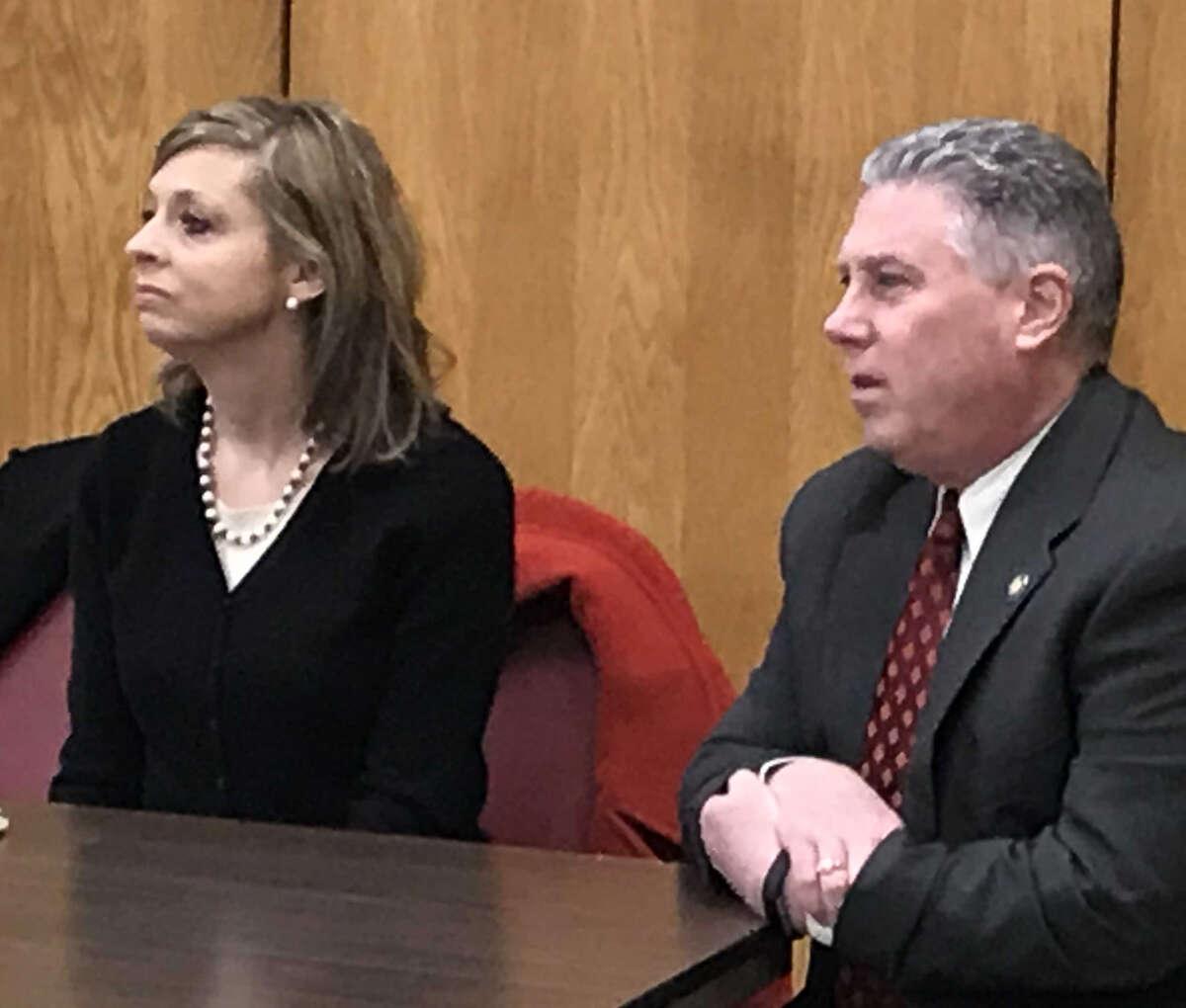 Cohoes City School District Superintendent Jennifer Spring and Assemblyman John T. McDonald III, D-Cohoes, listen at Cohoes Community Center forum Thursday.