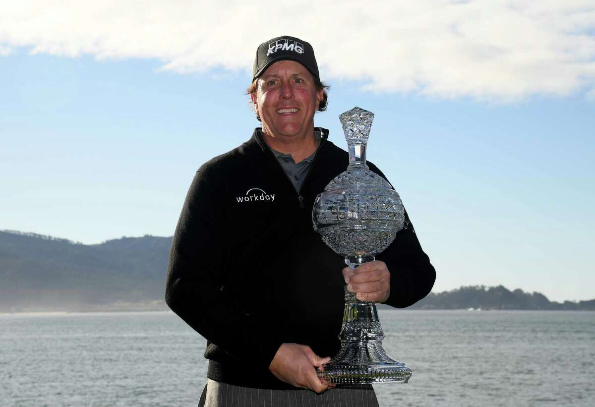 PEBBLE BEACH, CALIFORNIA - FEBRUARY 10: Phil Mickelson poses with the trophy after his victory during the continuation of the final round of the AT&T Pebble Beach Pro-Am at Pebble Beach Golf Links on February 10, 2019 in Pebble Beach, California. (Photo by Harry How/Getty Images)