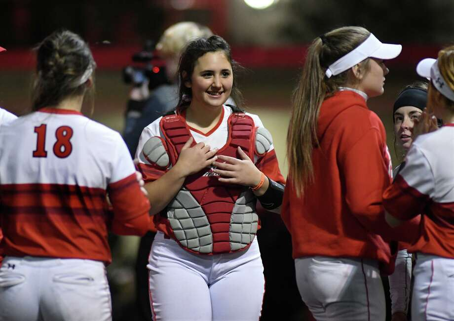 Crosby catcher Maggie Herdejurgen, center, is all smiles after the Cougar's shutout win over Baytown Lee in their District 22-5A matchup at Crosby High School on March 5, 2019. Photo: Jerry Baker, Houston Chronicle / Contributor / Houston Chronicle