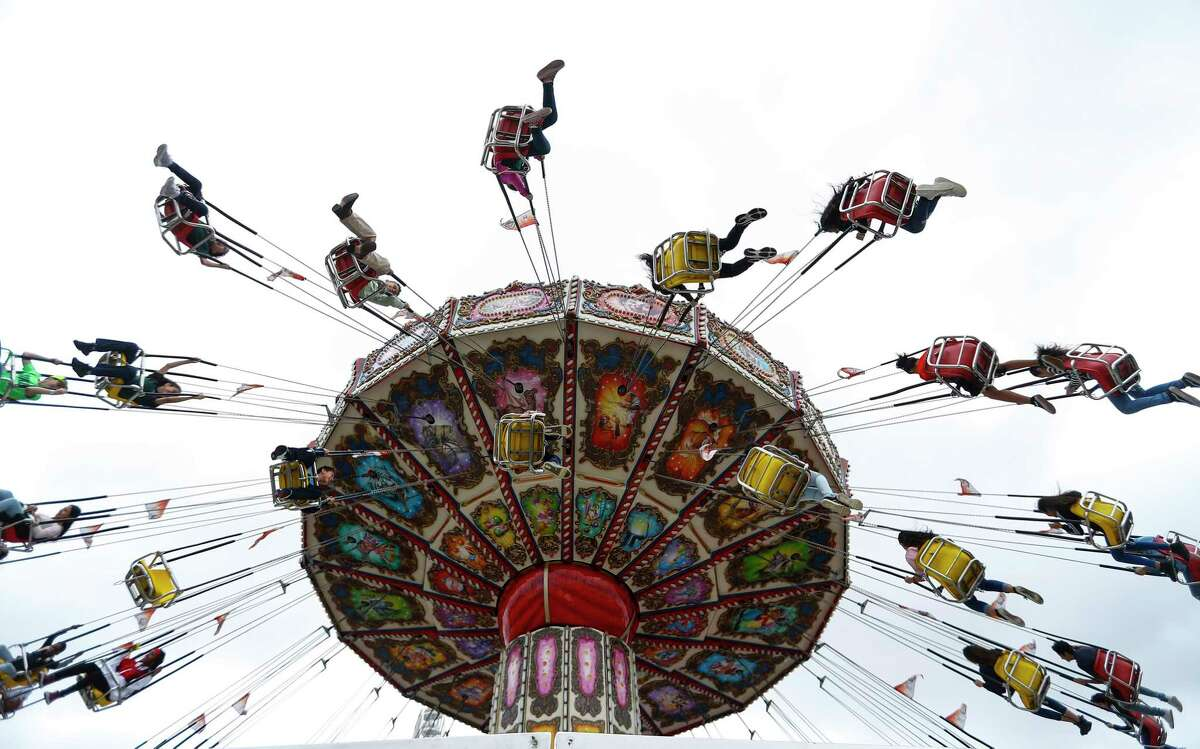 Kids ride in the Junction area at the Houston Livestock Show and Rodeo at NRG Center, Thursday, March 7, 2019, in Houston.