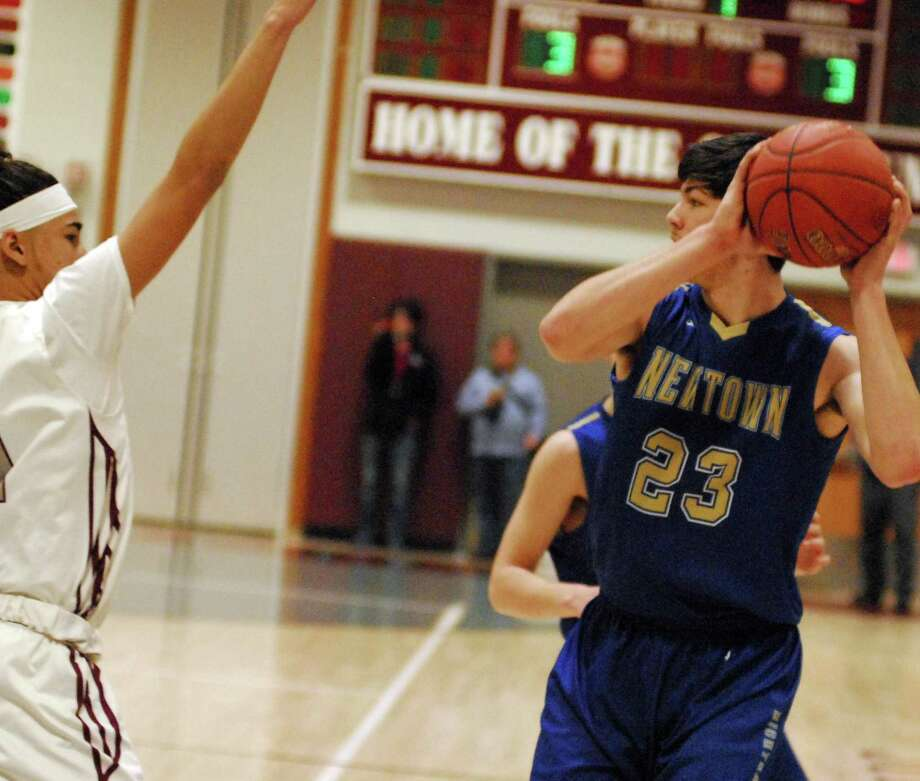 Newtown's Todd Petersen looks to make a pass during a game against Naugatuck on Thursday. Photo: Ryan Lacey /Hearst Connecticut Media