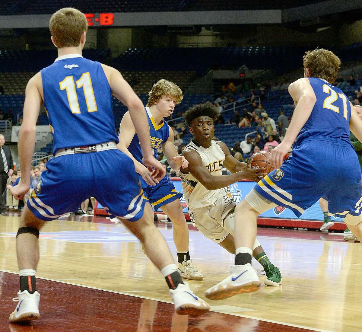 East Chambers' Ernest Ceasar drives against Brock's Bradon Smith during their state semi-final match-up Thursday at the Alamodome. Photo taken Thursday, March 7, 2019 Kim Brent/The Enterprise