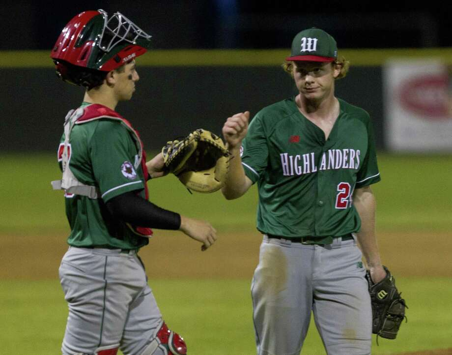 The Woodlands catcher Drew Romo (23) gets a fist-bump from starting pitcher Will Swope (24) after defeating College Park 13-0 in five innings during a District 15-6A high school baseball game at College Park High School, Thursday, March 7, 2019, in The Woodlands. Photo: Jason Fochtman, Houston Chronicle / Staff Photographer / © 2019 Houston Chronicle