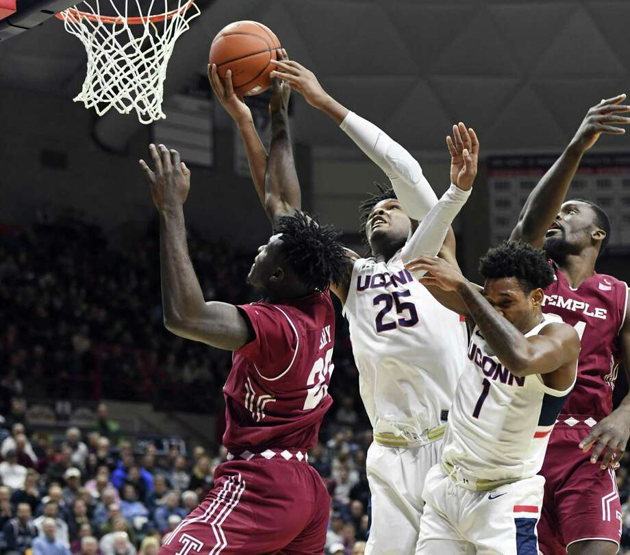 UConn's Josh Carlton (25) battles for a rebound against Temple on Thursday. Photo: Stephen Dunn / Associated Press / Copyright 2019 The Associated Press. All rights reserved