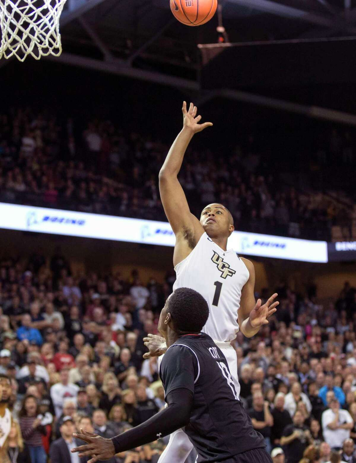 Central Florida guard B.J. Taylor (1) makes the last point of the game against Cincinnati forward Tre Scott (13) during the second half of an NCAA college basketball game, Thursday, March 7, 2019, in Orlando, Fla. (AP Photo/Willie J. Allen Jr.)