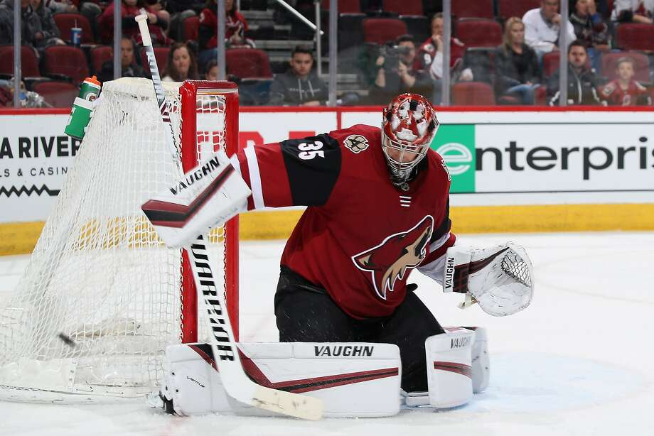 Arizona goalie Darcy Kuemper makes a pad save in the second period of the Coyotes' win over Calgary. Photo: Christian Petersen / Getty Images