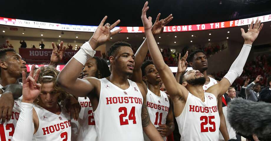 Houston guard Landon Goesling (2), forward Breaon Brady (24) and guard Galen Robinson Jr. (25) celebrate after beating Southern Methodist 90-79 to win at least a share of the American Athletic Conference title at Fertitta Center on Thursday, March 7, 2019, in Houston. Photo: Brett Coomer/Staff Photographer