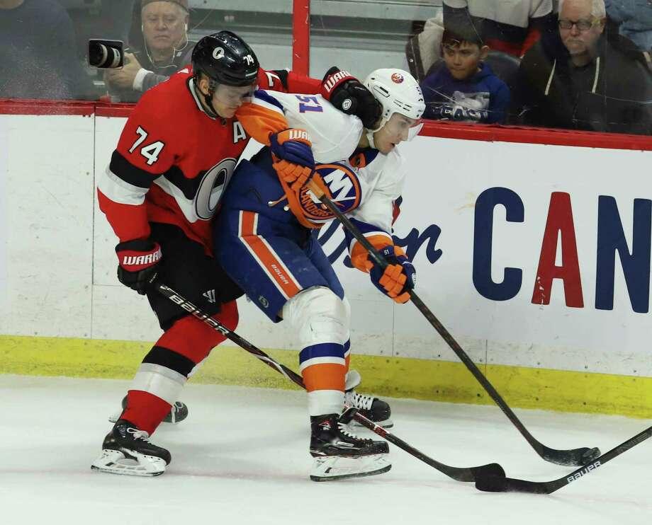 ca3be68b216 Ottawa Senators defenseman Mark Borowiecki (74) and New York Islanders  center Valtteri Filppula (