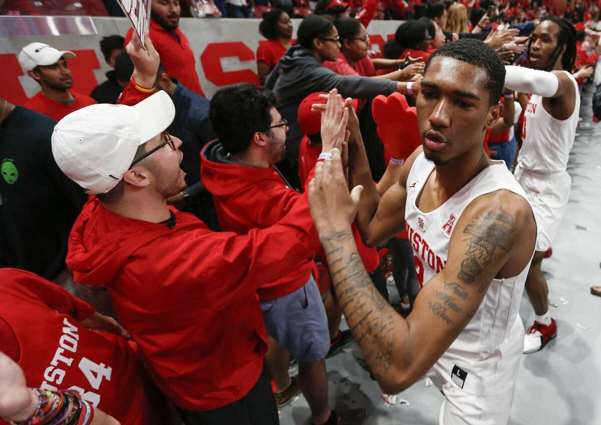 PHOTOS: Cougars return to Houston after NCAA Tournament Houston guard Armoni Brooks (3) high fives fans as he celebrates with his teammates after beating Southern Methodist 90-79 to win at least a share of the American Athletic Conference title at Fertitta Center on Thursday, March 7, 2019, in Houston. >>>See fans welcome the men's basketball team back to Houston, one day after their banner season ended in a loss to Kentucky in the Midwest Region semifinals of the NCAA Tournament ...