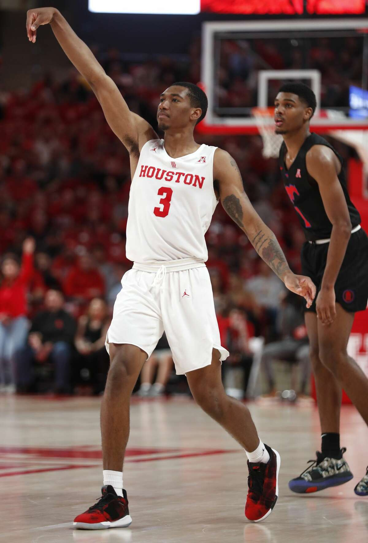 Houston guard Armoni Brooks (3) watches the flight of his 3-pointer against Southern Methodist during the second half of an NCAA basketball game at Fertitta Center on Thursday, March 7, 2019, in Houston.