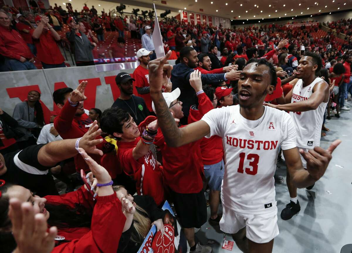 Houston guard Dejon Jarreau (13) high fives fans as the Cougars celebrate after beating Southern Methodist 90-79 to with the AAC at Fertitta Center on Thursday, March 7, 2019, in Houston.