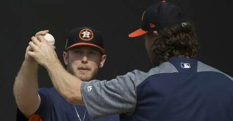 Houston Astros right handed pitcher Gerrit Cole (45) helps J.B. Bukauskas (69) with his pitching grips at bullpen at Fitteam Ballpark of The Palm Beaches on Day 9 of spring training on Friday, Feb. 22, 2019, in West Palm Beach.