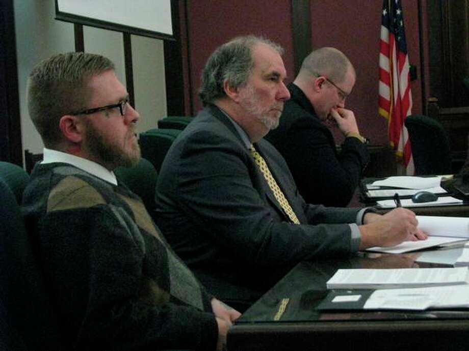 Joel Wallace, left, appears in the 42nd Circuit Court alongside his attorney Dan Duke, center, on March 7, 2019. Wallace is accused of the murder of his great-aunt, Victoria Kilbourne.