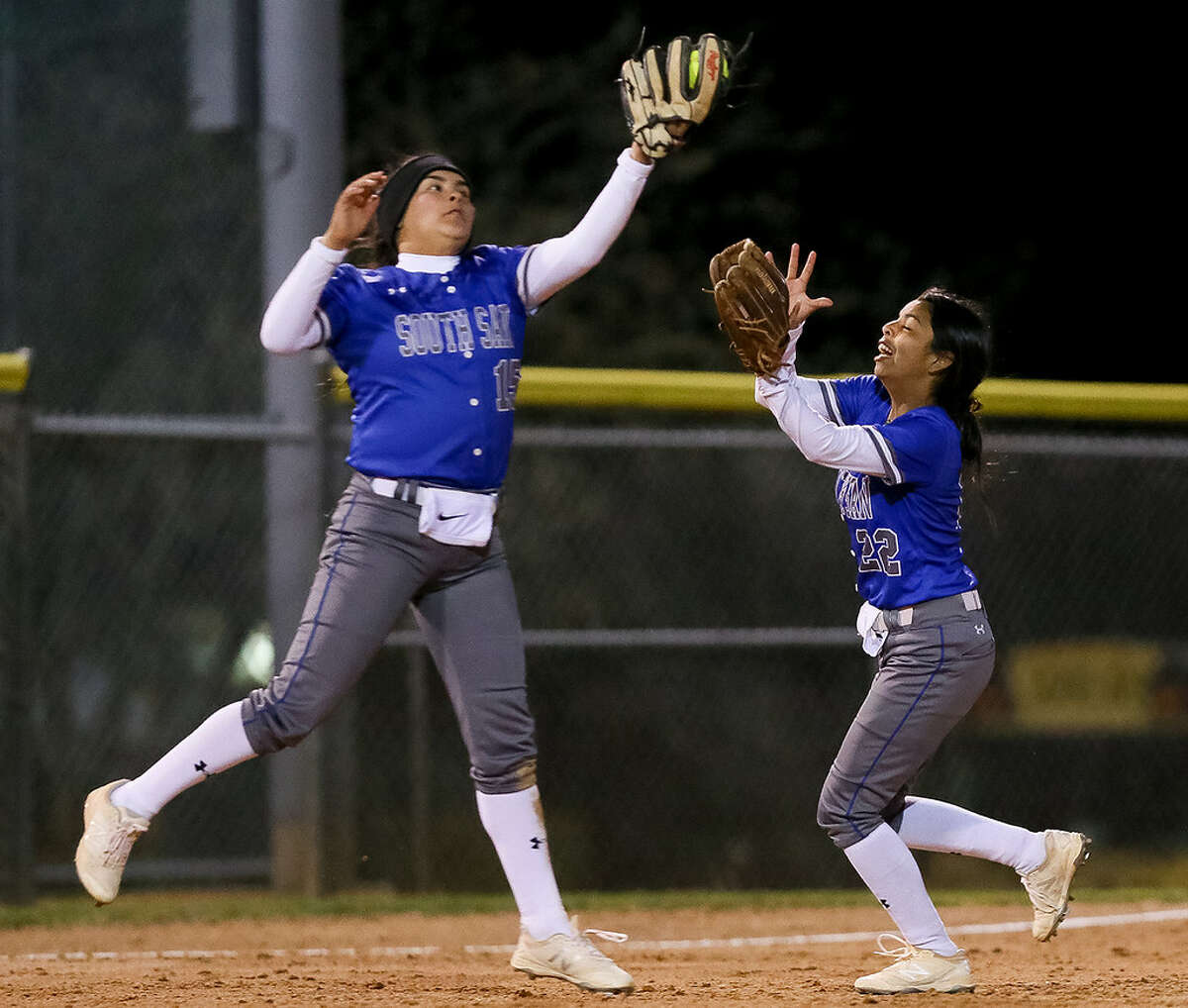 South San's Skye Estrada, left, makes a catch to end the first inning as Emerie Poblano comes in to help during their high school softball game with MacArthur at NEISD Softball Complex's West Field on Tuesday, March 5, 2019.