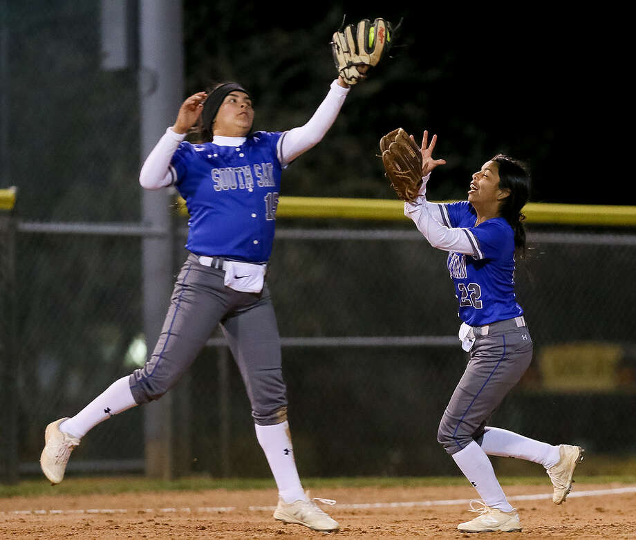 South San's Skye Estrada, left, makes a catch to end the first inning as Emerie Poblano comes in to help during their high school softball game with MacArthur at NEISD Softball Complex's West Field on Tuesday, March 5, 2019. Photo: Marvin Pfeiffer