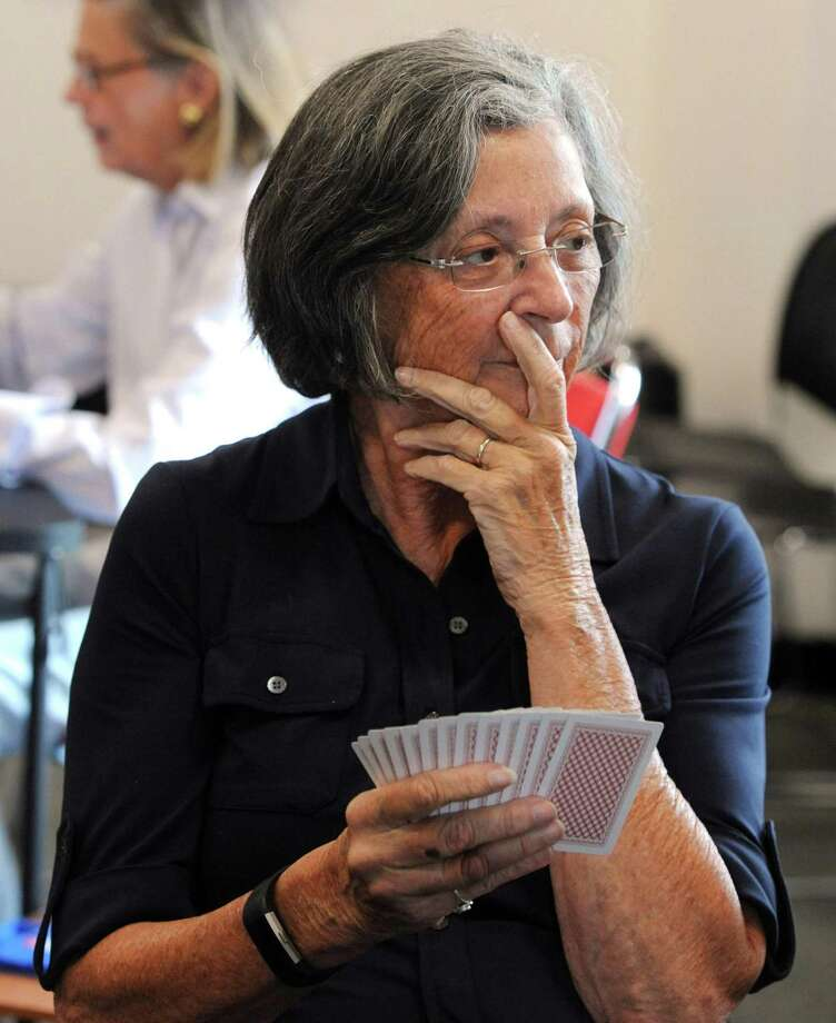 Paula Bertolotti contemplates her next move at the Perfectly Polite Bridge Group at the YMCA in Greenwich, Conn on Wednesday, June 27, 2018. The weekly group, run by Frank Crocker, consists of lecture/discussion and supervised play with a focus on beginners. Photo: File / Hearst Connecticut Media / Greenwich Time