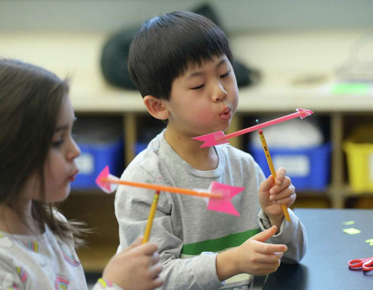 Kindergartner Nico Chan tests out his homemade weather vane during a visit from the Talcott Mountain Science Center at Old Greenwich School in Old Greenwich, Conn. Wednesday, Feb. 20, 2019. The school recently installed a fully equipped weather station that gives accurate temperature, wind and barometric readings.