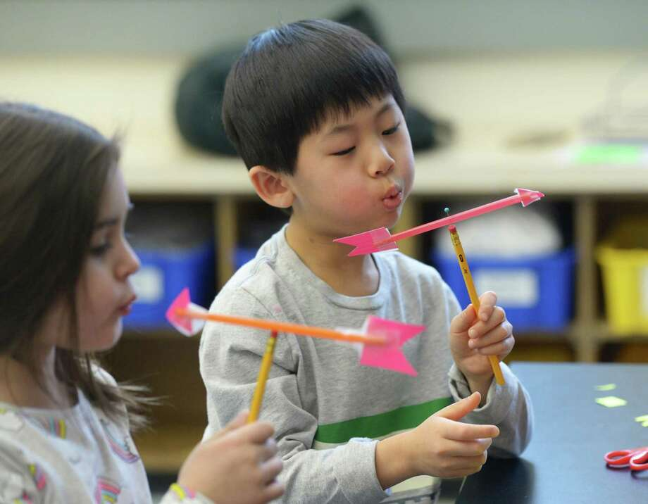 Kindergartner Nico Chan tests out his homemade weather vane during a visit from the Talcott Mountain Science Center at Old Greenwich School in Old Greenwich, Conn. Wednesday, Feb. 20, 2019. The school recently installed a fully equipped weather station that gives accurate temperature, wind and barometric readings. Photo: Tyler Sizemore / Hearst Connecticut Media / Greenwich Time